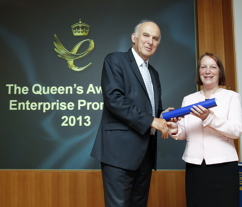 Vince Cable, Business Secretary with Lady Cunningham, as she rec
